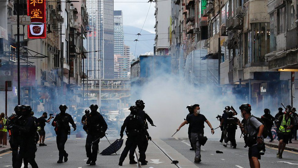 Street view of riot police and protesters in Hong Kong