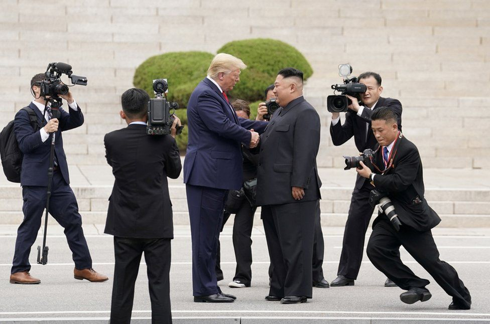 President Donald Trump meets with North Korean leader Kim Jong Un at the demilitarized zone separating the two Koreas, 30 June 2019.