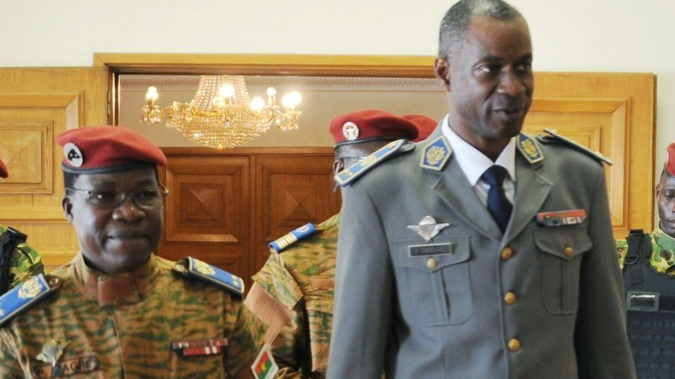 Burkina Faso's army chief General Pingrenoma Zagre (L) walks with coup leader General Gilbert Diendere (R) on 23 September 2015 at Ouagadougou International Airport