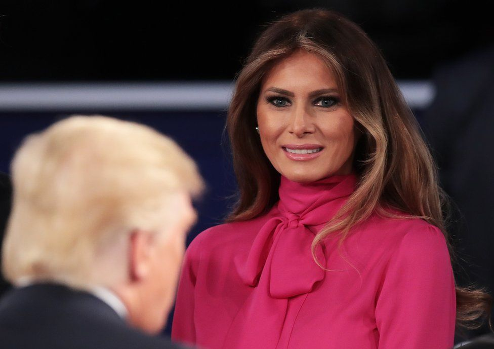 Melania Trump (right) greets her husband after the town hall debate at Washington University on October 9, 2016.
