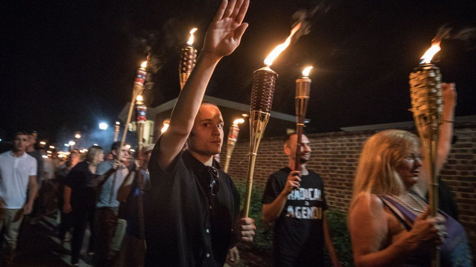 """At a 2017 rally in Charlottesville, far-right activists chanted """"Jews will not replace us"""""""