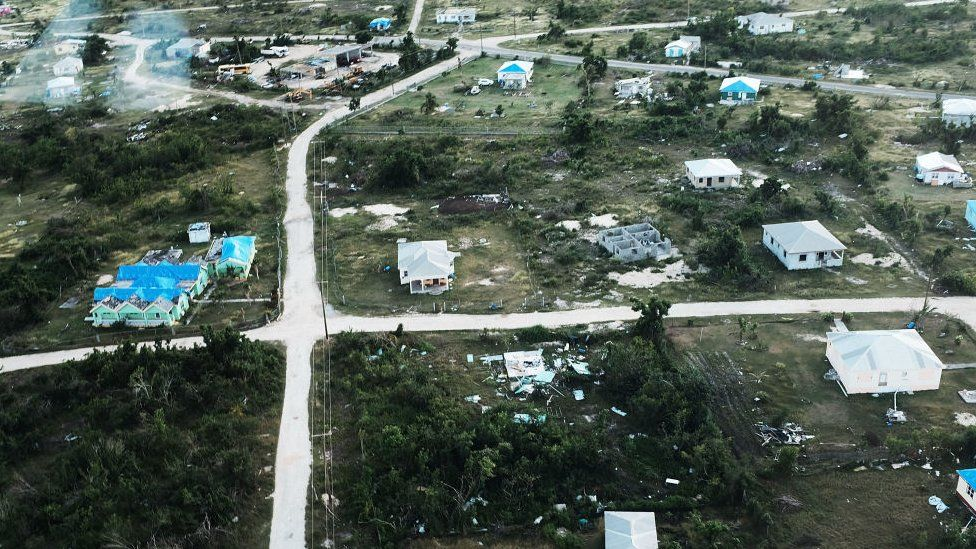 An aerial view of damaged homes on the nearly destroyed island of Barbuda on December 8, 2017 in Cordington, Barbuda.