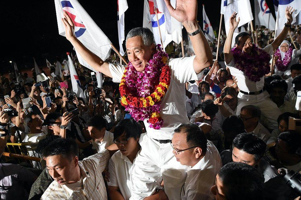 Singapore's Prime Minister Lee Hsien Loong, of the People's Action Party celebrates after winning the general election in Singapore on 12 September 2015
