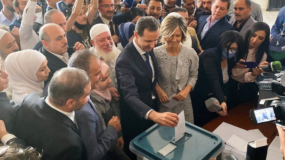 Bashar al-Assad and his wife Asma vote in Syria's presidential election in Douma, near Damascus, on 26 May 2021