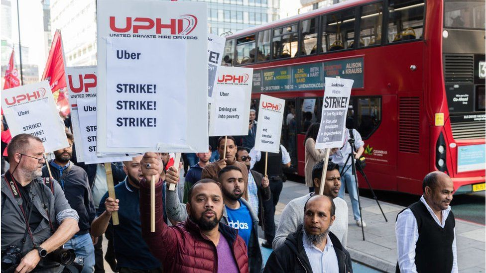 Uber drivers on strike in London in October demanding employment rights