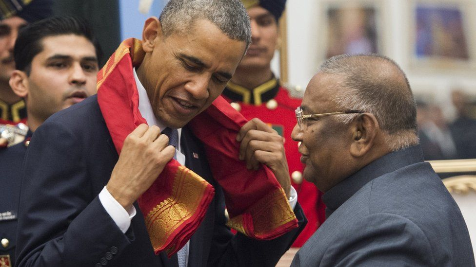 Rayapati Sambasiva Rao, Member of Indian Parliament, presents a scarf to US President Barack Obama in New Delhi, India.