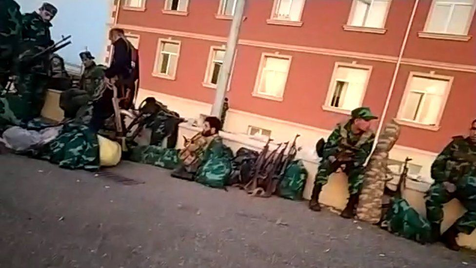 Syrian mercenaries on strike outside their barracks in Azerbaijan