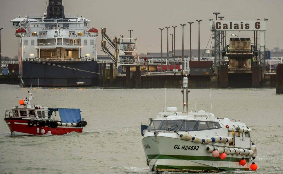 Fishing boats leave the harbour of Calais on January 25, 2018 to take part in a blockade to protest against electric pulse fishing