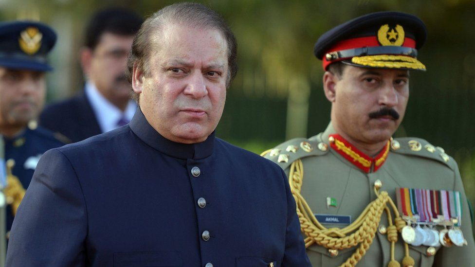 Nawaz Sharif inspects a guard of honour during a welcoming ceremony at the Prime Minister's House in Islamabad, 28 July 2017