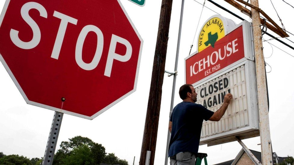 """Bar owner Petros Markantonis changes the marquee outside his bar to """"Closed Again"""" at the West Alabama Ice House in Houston, Texas, 26 June 2020"""