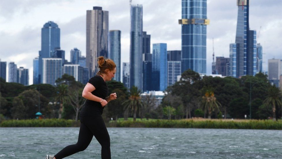A woman jogs in Melbourne