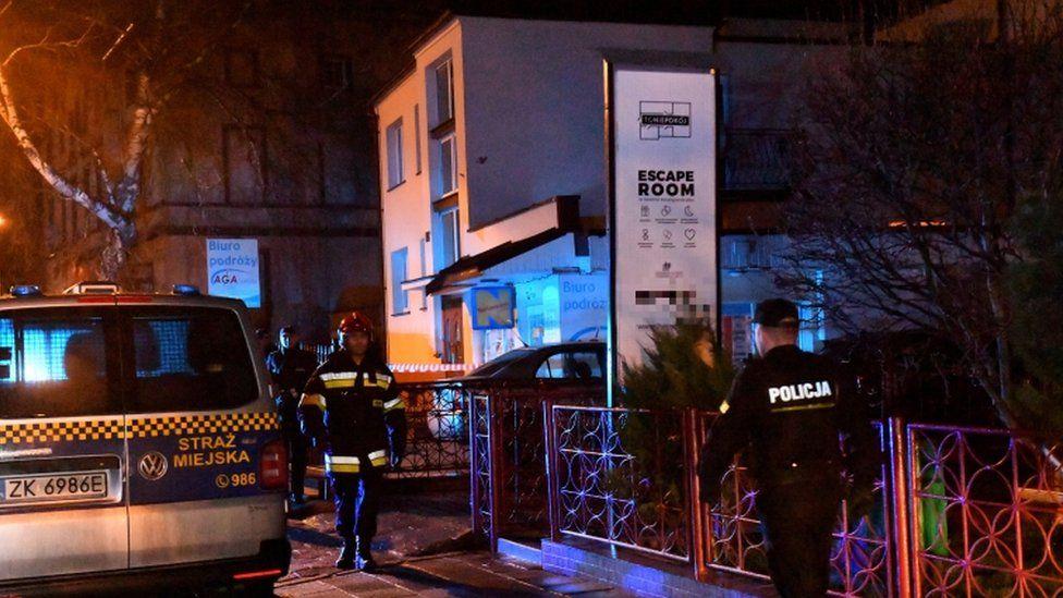 Police secure a scene of a fire in Koszalin, Poland, 4 January 2019