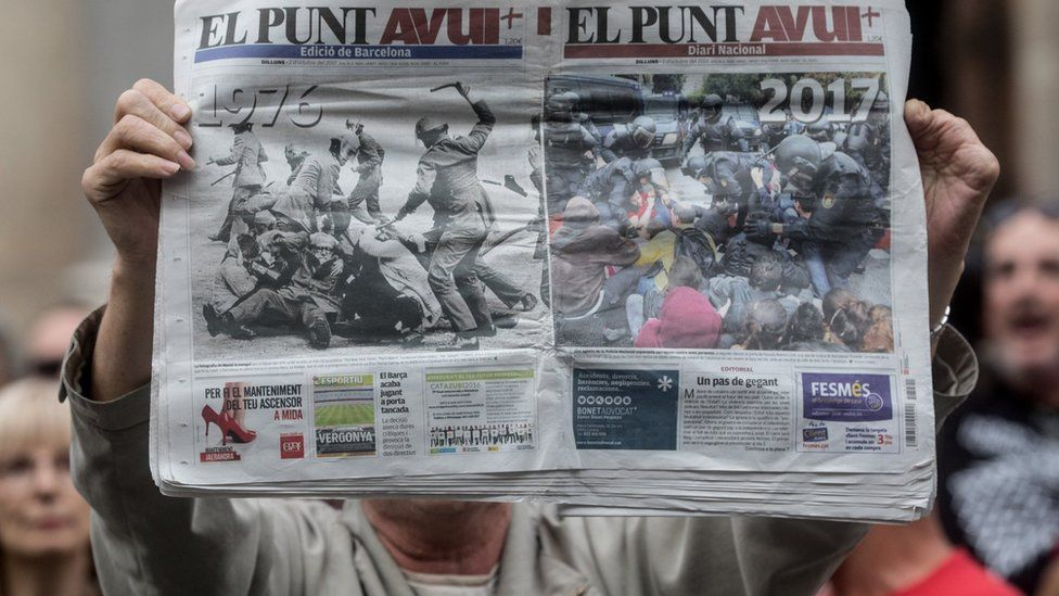A man holds up a newspaper showing images of police violence during protest in Barcelona against the violence that marred a referendum. 2 October, 2017 in Barcelona