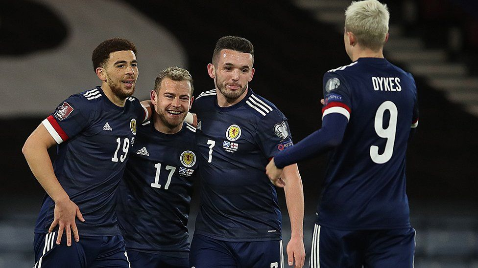 Che Adams celebrates scoring for Scotland