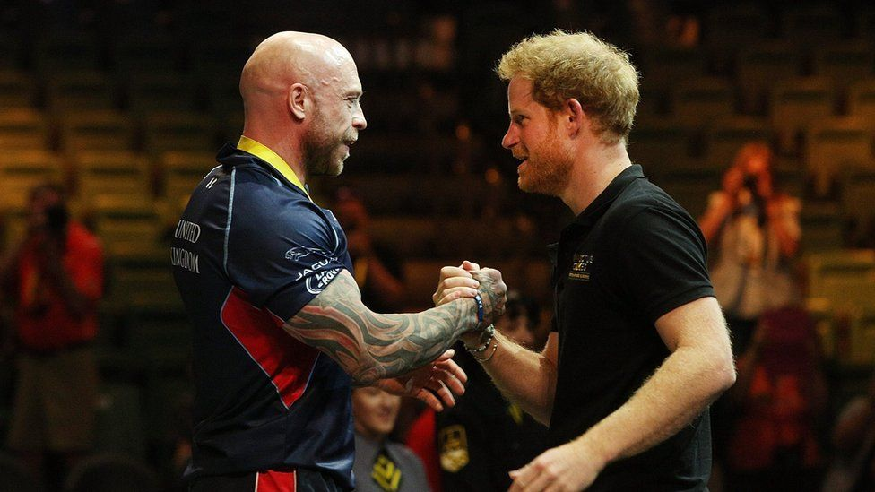 Michael Yule receives a handshake from Prince Harry of Wales after winning the gold medal in the Men's Lightweight Powerlifting finals during the Invictus Games Orlando 2016