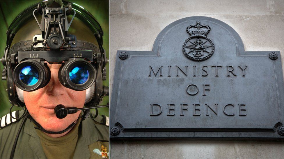 An RAF serviceman wearing night vision goggles and a MoD plaque