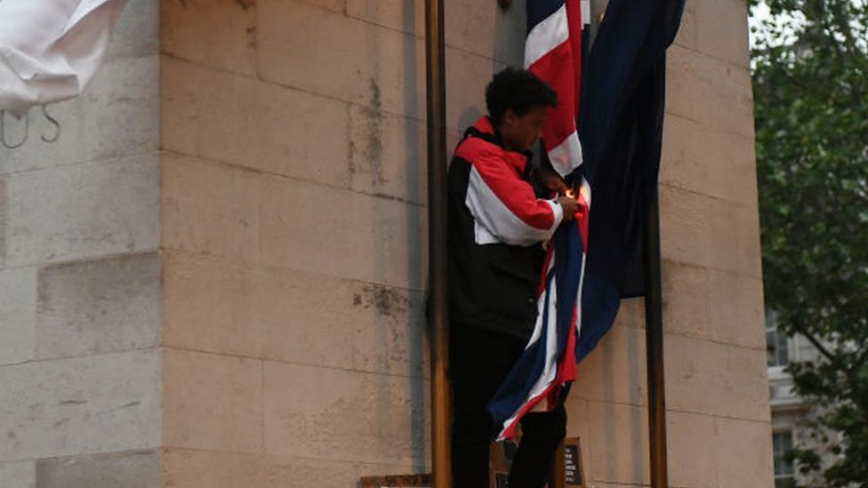 The person who climbed onto the Cenotaph during protests