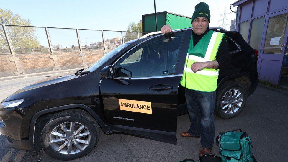 Jonathan Ganesh with the donated ambulance car