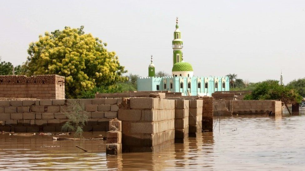 A mosque and house walls are partially submerged in water following heaving floods in Wad Ramli, some 45 km north of Khartoum, Sudan, 25 August 2019.