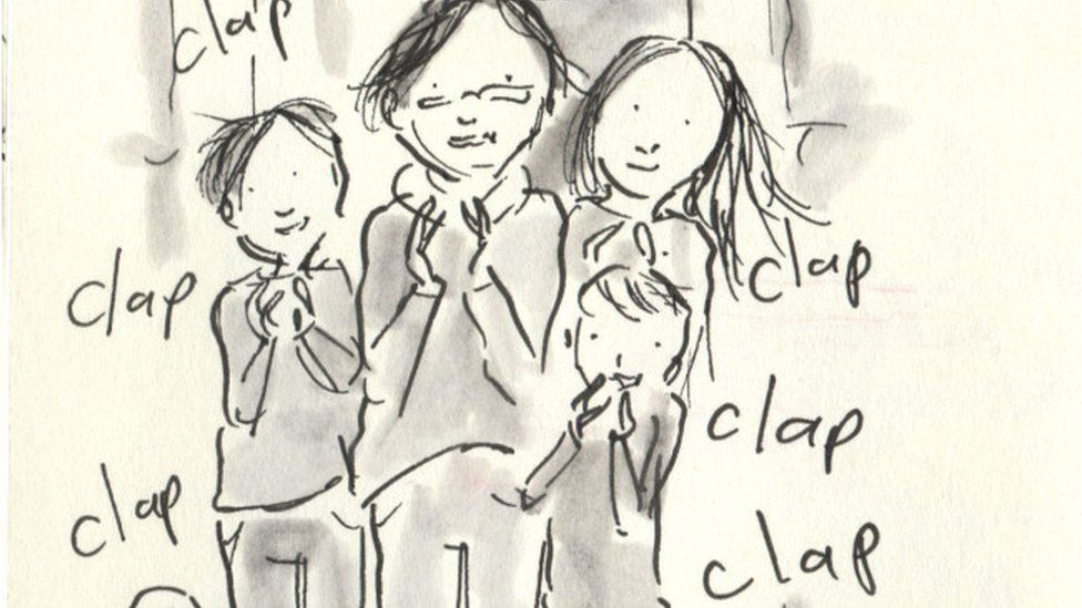 The family clapping NHS workers