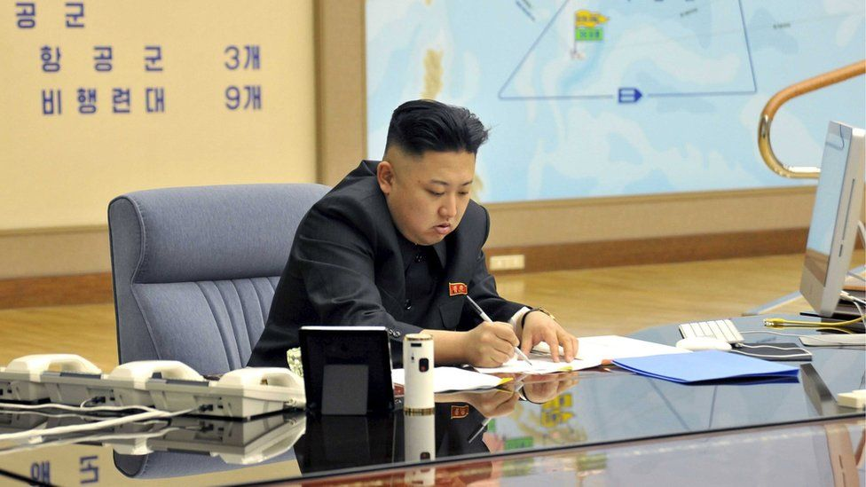 """North Korean leader Kim Jong-un presides over an operation meeting on the Korean People""""s Army Strategic Rocket Force""""s performance of duty for firepower strike at the Supreme Command in Pyongyang, in this March 29, 2013"""