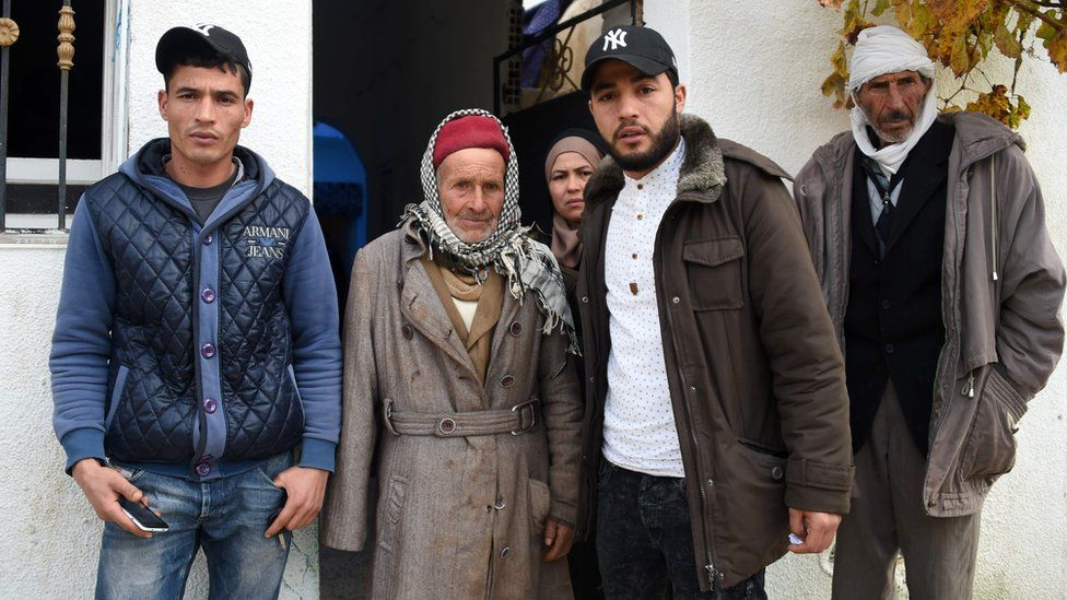Mustapha Amri (2ndL), father of Anis Amri, next to his children Walid (L), Hanan (C), and Abdelkader and his brother (R) in front the family house in the town of Oueslatia, in Tunisias region of Kairouan on December 22, 2016