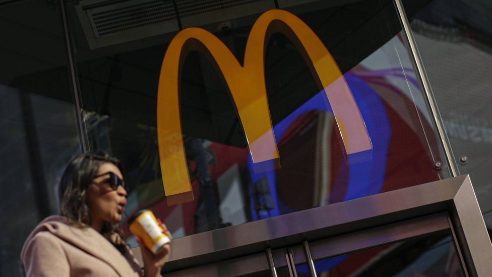 A woman walk pass McDonald's restaurant in Times Square following the firing of their CEO, Steve Easterbrook on November 4, 2019 in New York City