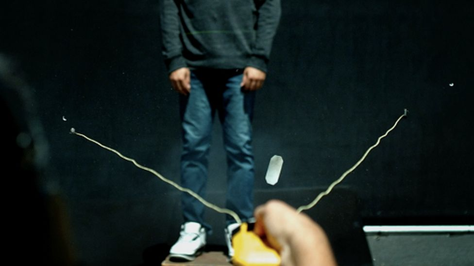 The BolaWrap, a device designed to entangle an individual in a cord, being used in a test