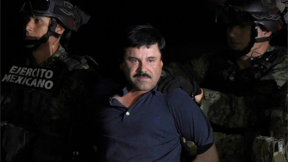 """Drug kingpin Joaquin """"El Chapo"""" Guzman is escorted into a helicopter at Mexico City""""s airport following his recapture during an intense military operation in Los Mochis, in Sinaloa State"""