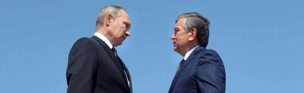 Shavkat Mirziyoyev (R) and Vladimir