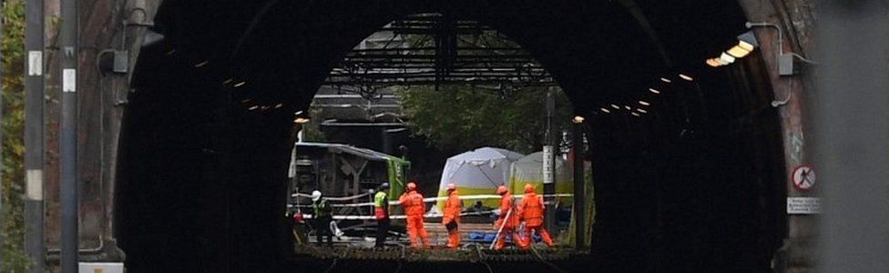 Emergency workers continue to work at the scene of a derailed tram in Croydon