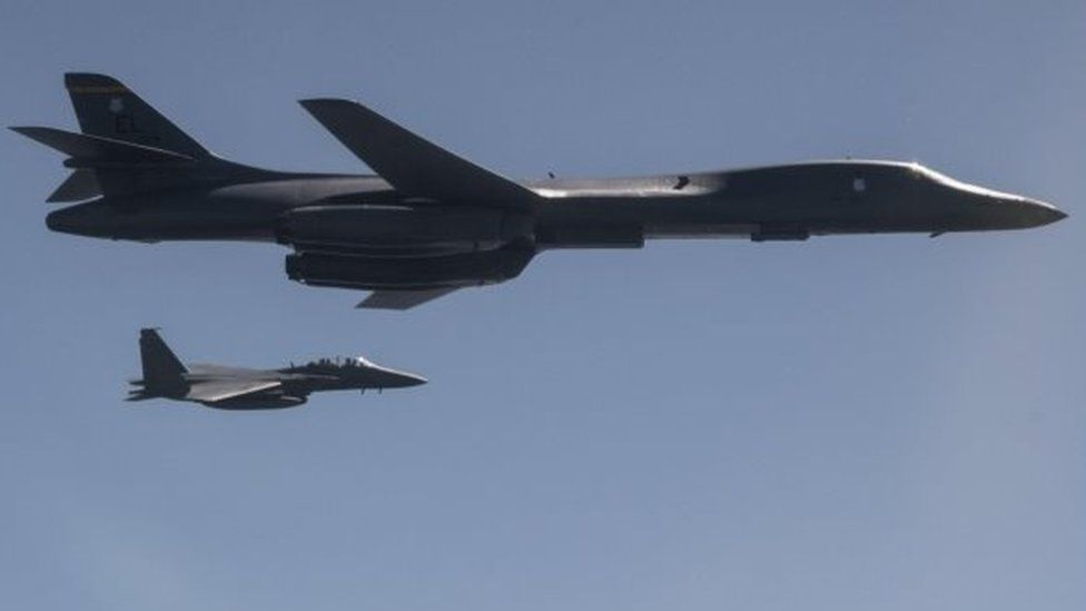 A US Air Force B-1B Lancer, flanked by Republic of Korea Air Force fighter, taking part in a show of force exercise in response to North Korean ballistic missile tests (18 September 2017)
