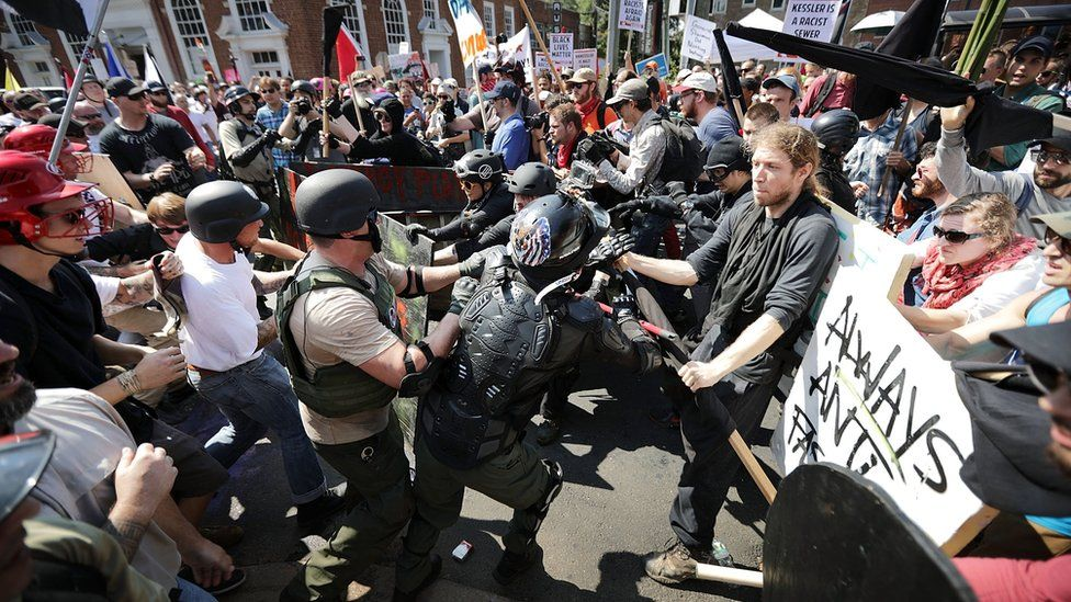 """White nationalists, neo-Nazis and members of the """"alt-right"""" clash with counter-protesters in Charlottesville on 12 August, 2017"""