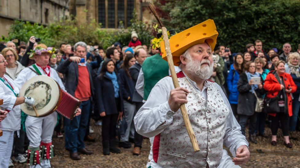 Oxford City Morris Men wearing a cheese hat