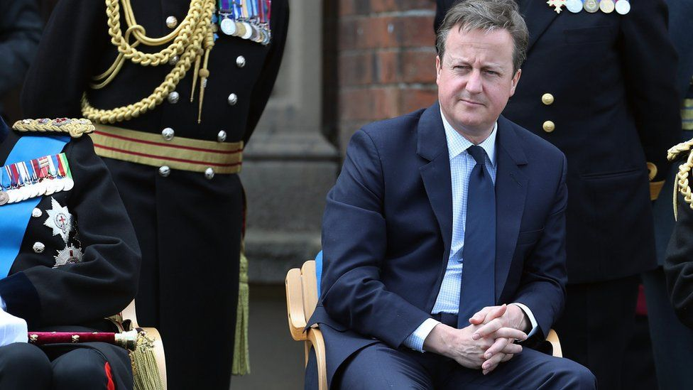 Prime Minister David Cameron watches parade during Armed Forces Day at Cleethorpes, England, Saturday June 25, 2016