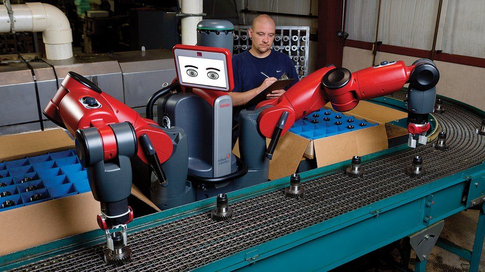 Man on a production line with one of Rethink's robots