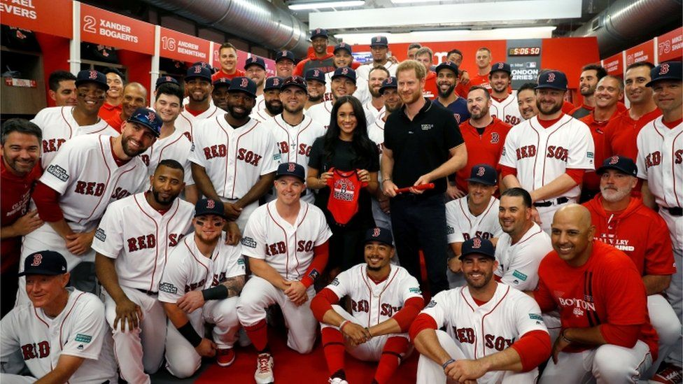 Not wanting to pick favourites, the couple also posed for a group photo with the Boston Red Sox