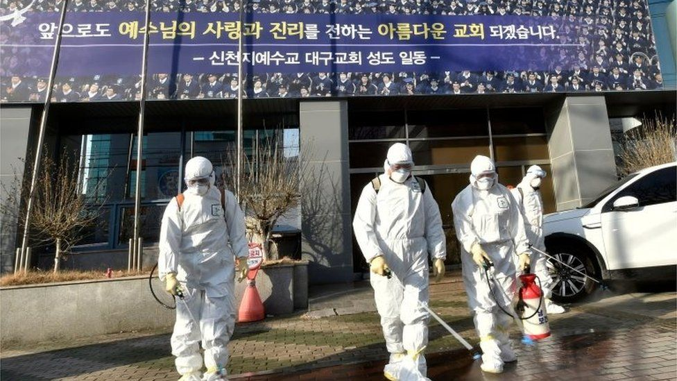 Workers spray disinfectant in front of the Daegu branch of the Shincheonji Church of Jesus, the Temple of the Tabernacle of the Testimony. Photo: 19 February 2020