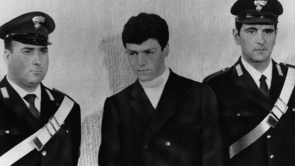 Raffaele Minichiello in court flanked by police