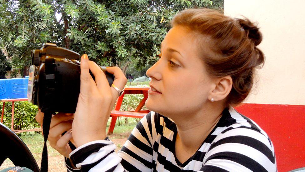 Rebecca Vassie looking at a camera