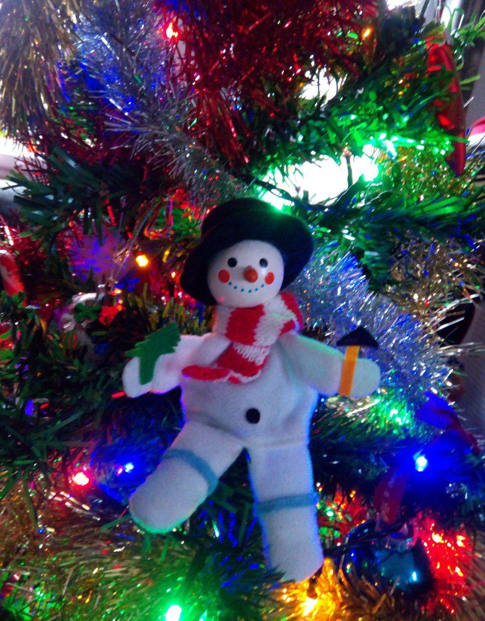 A snowman on a Christmas tree