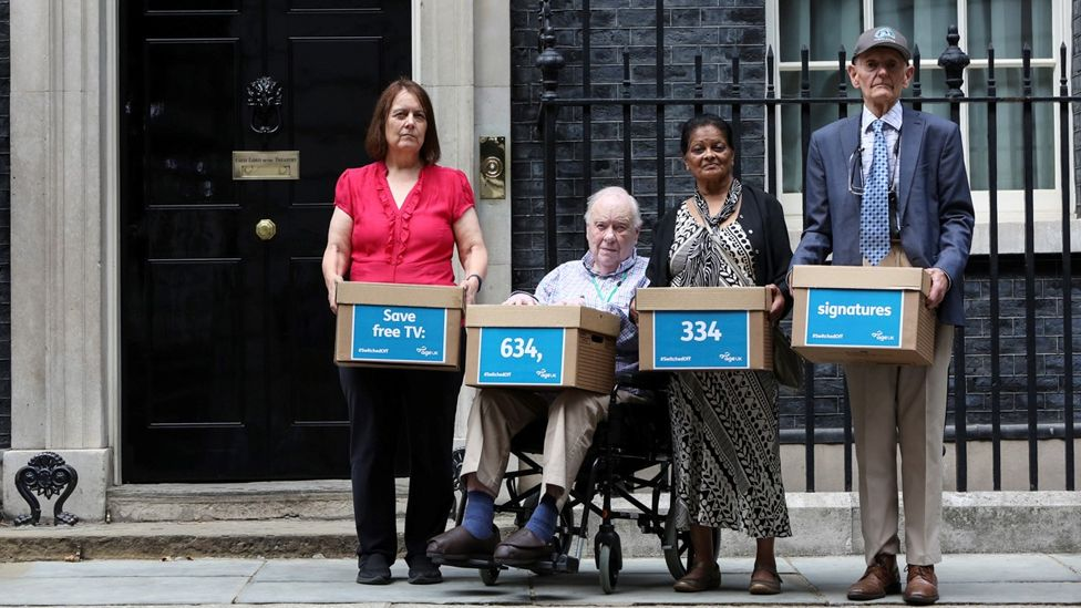 Campaigners from Age UK prepare to hand in a petition to maintain free TV licences for over-75s to 10 Downing Street