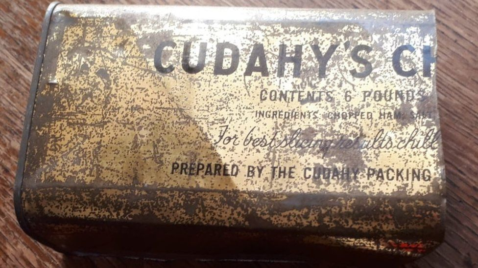 Tarnished tin container bearing the name Cudahy's