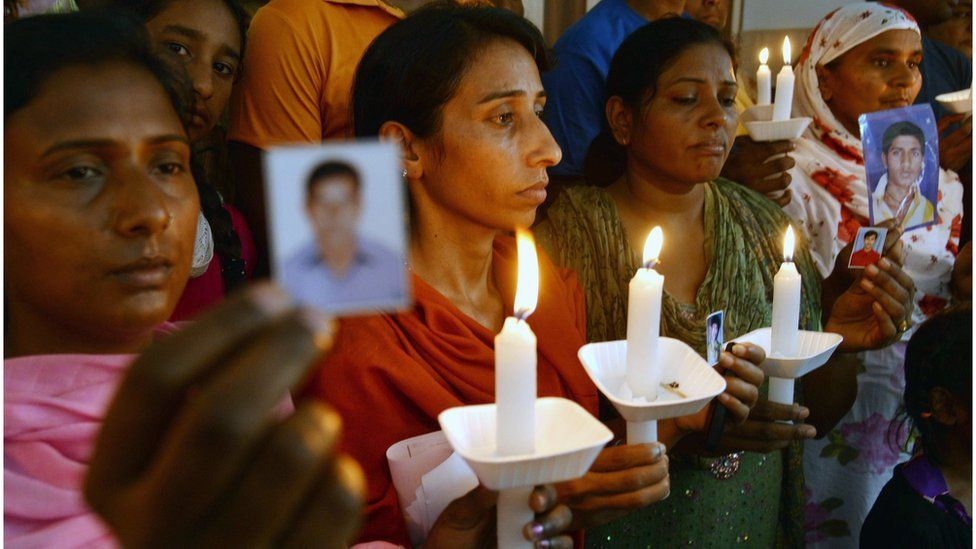 Relatives of Indian workers missing in Iraq pose at a church in Amritsar on June 26, 2014.