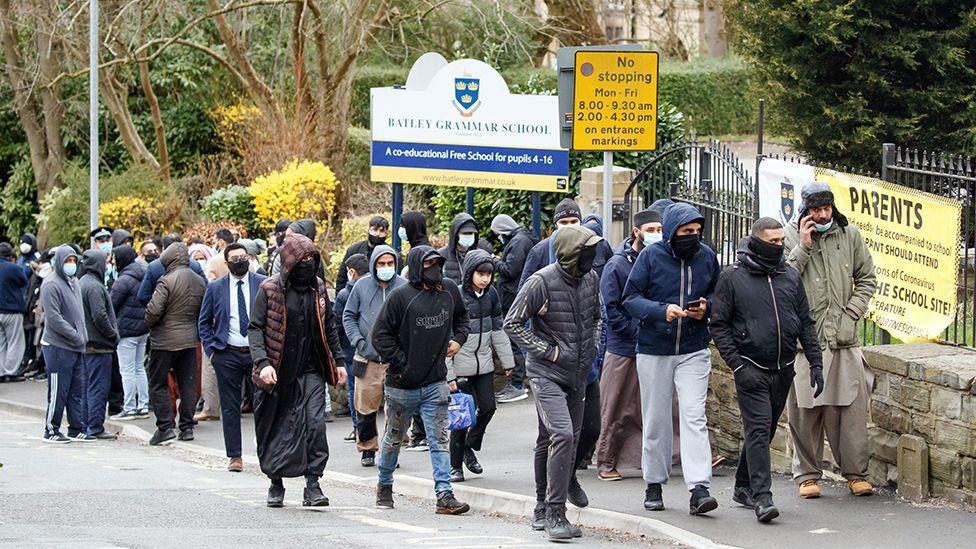 Protestors outside school