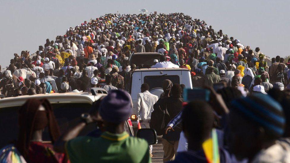 People crossing the bridge
