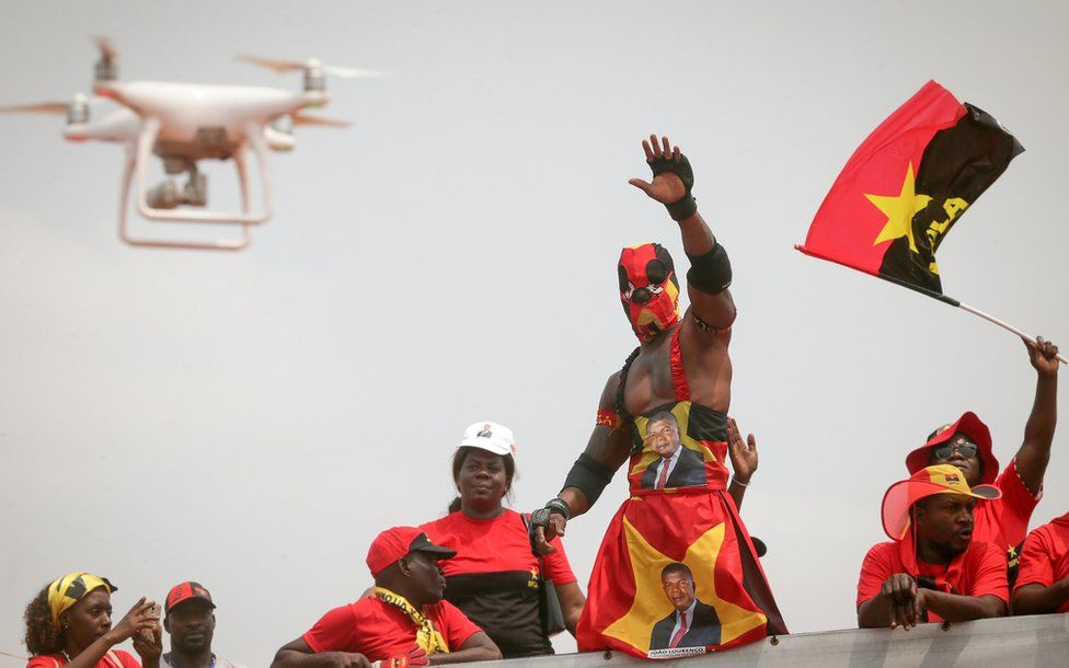 Supporters of Joao Lourenco (unseen), the candidate of the Popular Movement for the Liberation of Angola (MPLA), cheer during an elections campaign rally in Luanda, Angola, 19 August 2017.