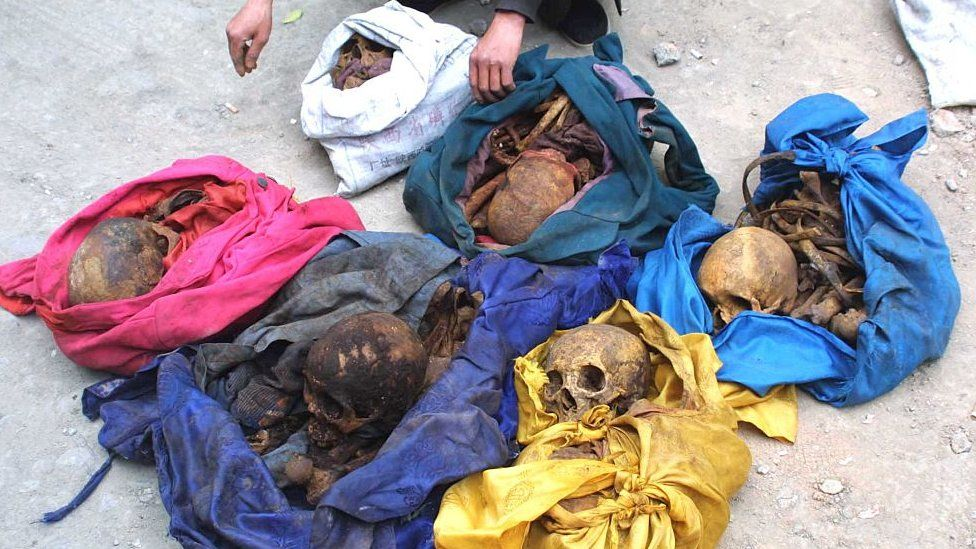 The image shows Yang Jinyu, a peasant from Xinghuo Village who stolen six skeletons of adult female to sell for ghost marriage is caught by police on March 28, 2005 in Xi'an