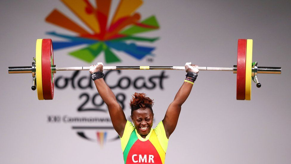Arcangeline Fouodji Sonkbou of Cameroon competes during the Women's 69kg final of Weightlifting on day four of the Gold Coast 2018 Commonwealth Games, Australia, April 8, 2018