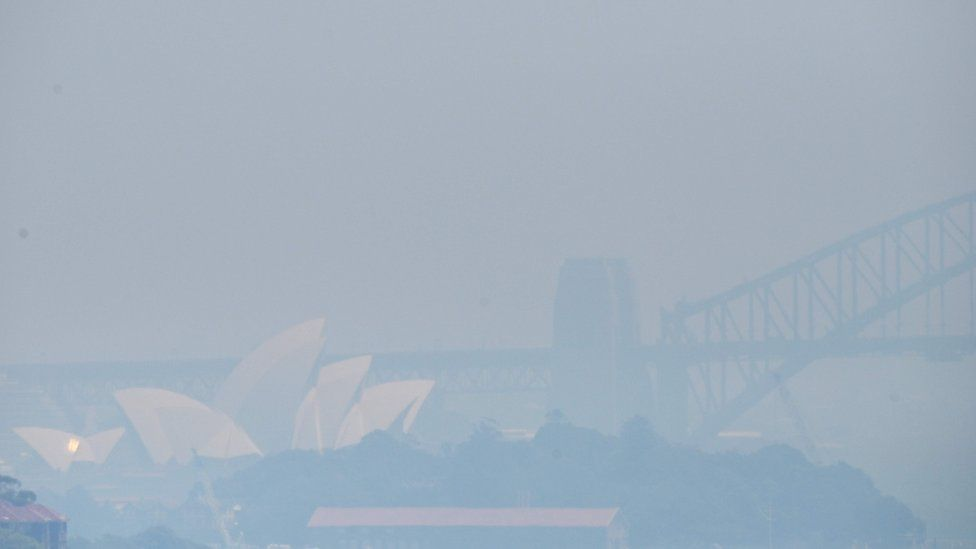 The Sydney Opera House and Harbour Bridge are obscured by a smoky haze on November 1, 2019.